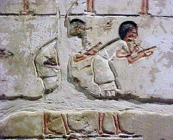 enlargement of scribes from a wall depicting everyday work during the Amarna period.